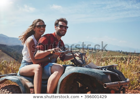 Portrait of smiling couple by off road vehicle Stock photo © wavebreak_media
