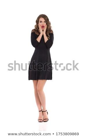 Verwonderd geschokt meisje permanente naar camera Stockfoto © deandrobot