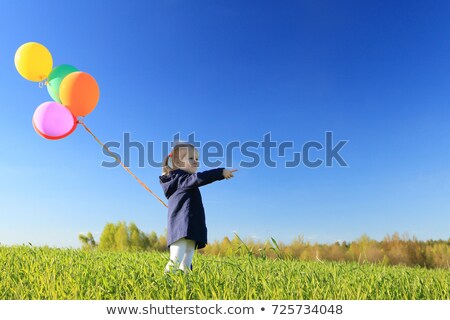 Woman and child pointing at sky Stock photo © IS2