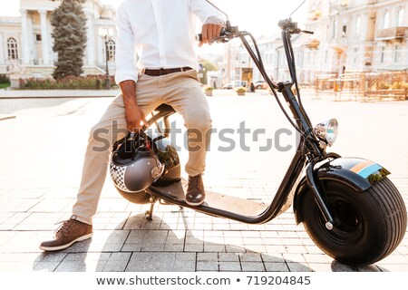 Cropped image of young african man sitting on modern motorbike Stock photo © deandrobot