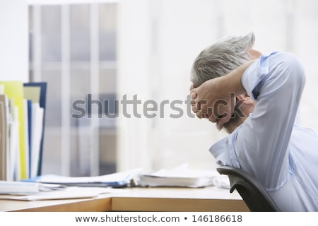 Сток-фото: деловой · человек · столе · голову · таблице · служба · бизнесмен