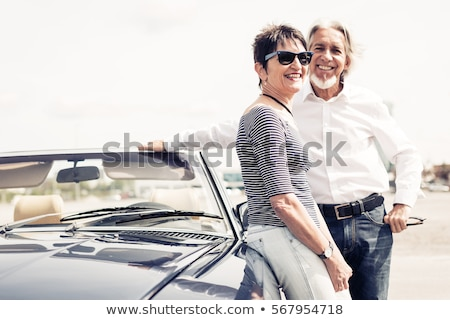 Stock photo: Couple in an old convertible
