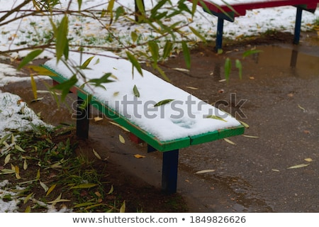 Children Playground In Public Park Covered With Winter Snow stock photo © stefanoventuri