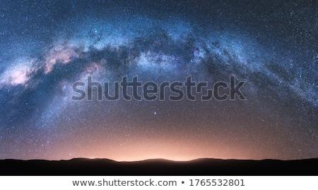 Milky Way. Fantastic night landscape with bright milky way Stock photo © denbelitsky