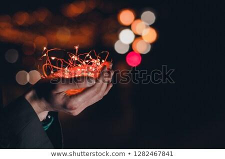 女性 · 手 · 文字列 · ライト · 暗い - ストックフォト © artjazz