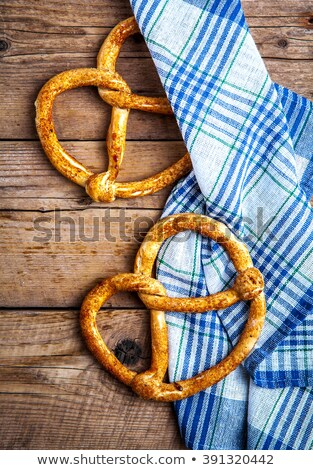 Pretzel and crackers on wooden board Stock photo © bluering