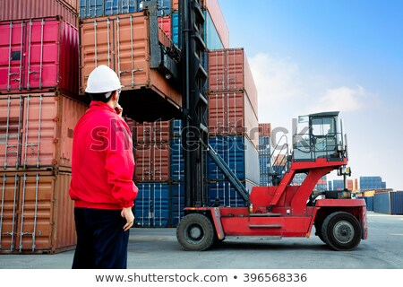 Stock photo: Workers with containers in warehouse
