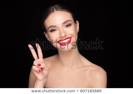 Mooie vrouw rode lippen tonen vrede gebaar afbeelding Stockfoto © deandrobot