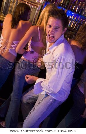 jonge · man · jonge · bodem · discotheek · vrouw · bier - stockfoto © monkey_business