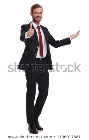 smiling businessman in navy suit makes thumbs up sign  Stock photo © feedough