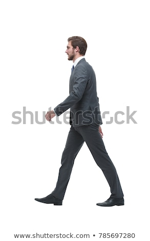 side view of handsome young businessman walking to work stock photo © feedough