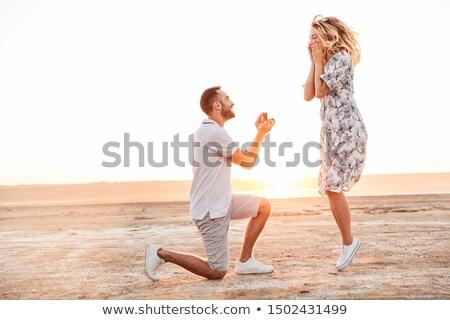 Fotó izgatott fiatalember nő randizás sétál Stock fotó © deandrobot