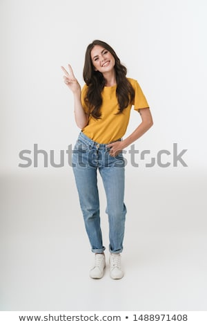 Full length portrait of smiling happy woman with long brown hair Stock photo © deandrobot