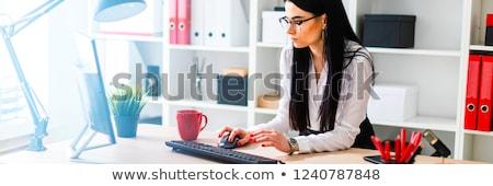 Jeune fille table clavier fille documents verres Photo stock © Traimak