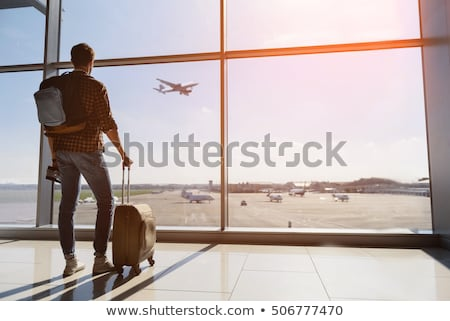 tourist man with backpack traveling by plane Stock photo © dolgachov