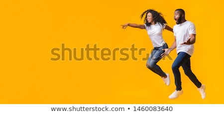full length of two happy male african friends stock photo © deandrobot
