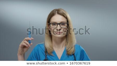 Kadın doktor şırınga uzun saçlı mavi tıbbi Stok fotoğraf © ruslanshramko