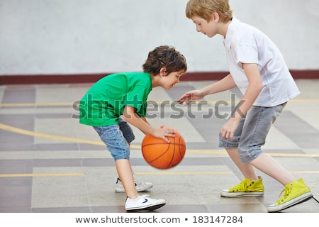 Students playing basketball in physical education Stock photo © colematt