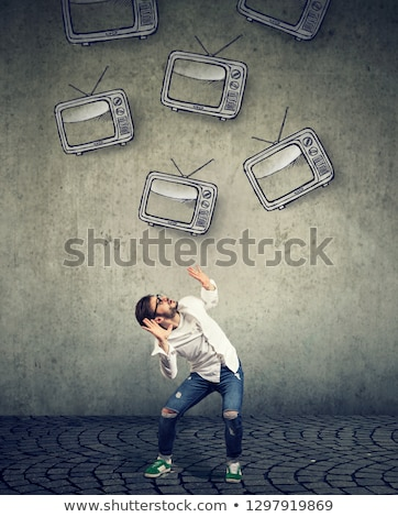 Multiple TV sets falling on a strssed scared man  Stock photo © ichiosea