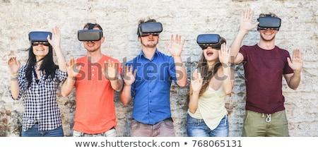 улыбаясь человека виртуальный реальность гарнитура улице Сток-фото © dolgachov