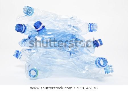 Jednorazowy plastikowe wody butelek posiedzenia rock Zdjęcia stock © jsnover