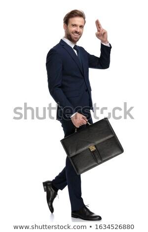 walking  elegant man greets with military salute Stock photo © feedough