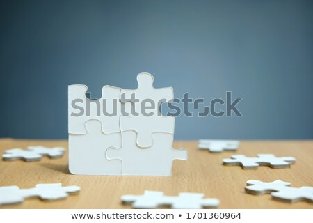 Human Figures Solving Jigsaw Puzzles Stock photo © AndreyPopov