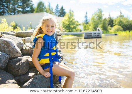 child with safety vest on the lake border Stock photo © Lopolo