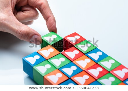 Businessperson's Hand Holding Green Cubic Block Stock photo © AndreyPopov