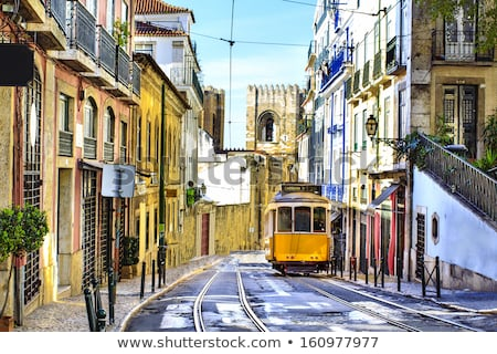 Old Lisbon tram and cityscape of city, Portugal landmarks, tramw Stock photo © Winner