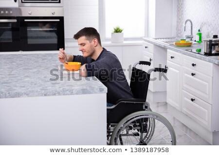 笑みを浮かべて 障害者 男 飲料 スープ キッチン ストックフォト © AndreyPopov