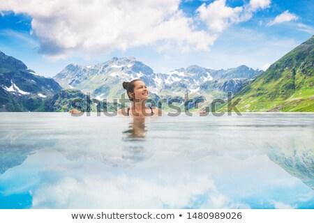 Photo femme infini piscine montagnes nature Photo stock © AndreyPopov