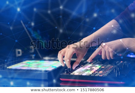 hand mixing music on midi controller with connectivity concept stock photo © ra2studio