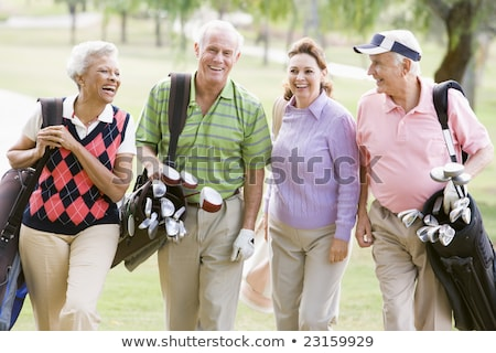Senior couple walking on golf course. Stock photo © lichtmeister