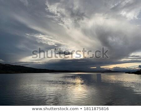 Seenlandschaft Silber Sonnenlicht Reflexion Himmel Wolken Stock foto © vapi