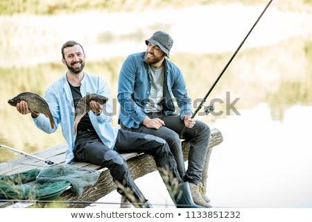 Gelukkig vrienden vis vissen pier recreatie Stockfoto © dolgachov