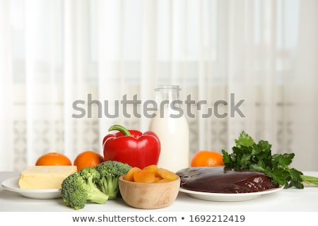 Foods for healthy liver on white wooden background. Stock photo © Illia