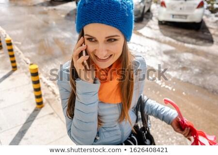 Kobieta telefonu spaceru błoto śniegu wody Zdjęcia stock © Kzenon