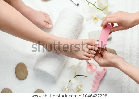 Pedicurist at Spa Salon, Woman Relaxing Pedicurist Stock photo © robuart