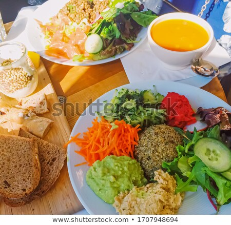 Vegan brunch in cafe, salad, soup and bread as healthy meal Stock photo © Anneleven