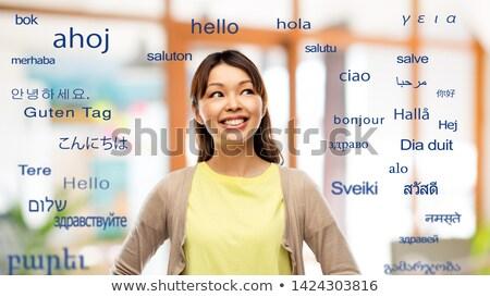 ázsiai nő felfelé néz külföldi nyelvek fordítás Stock fotó © dolgachov
