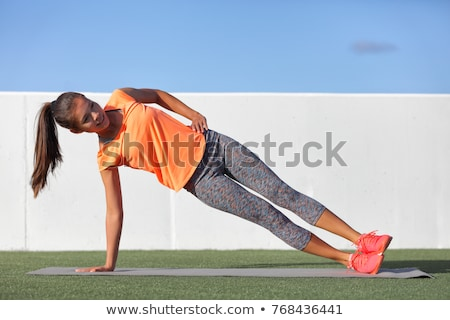 Side plank fitness woman training body core planking exercise. Workout at outdoor gym or home garden Stock photo © Maridav