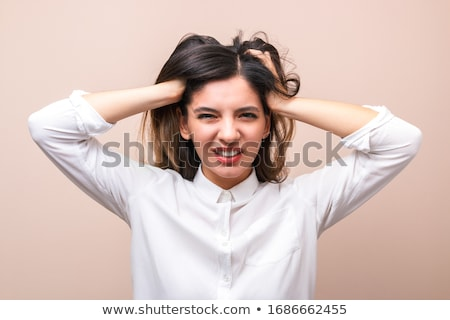 Businesswoman pulling at her shirt collar Stock photo © photography33