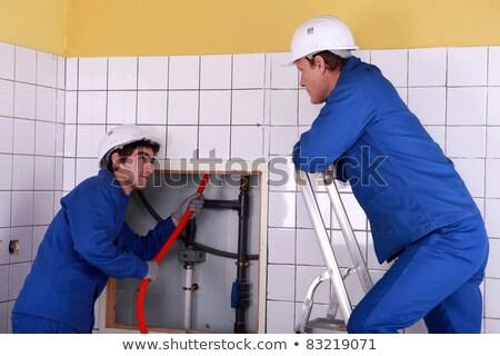 Aprendiz vermelho cabo para cima atrás azulejos Foto stock © photography33