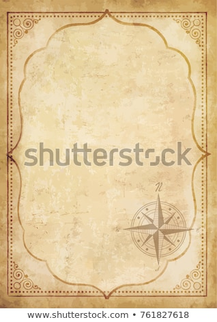 Сток-фото: Compass On The Old Paper Background