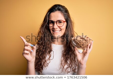 Woman with bowl of cereal stock photo © photography33