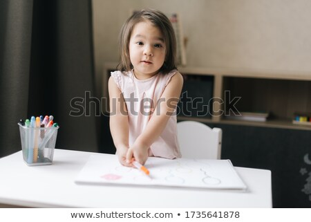 Little girl colouring with crayons Stock photo © photography33