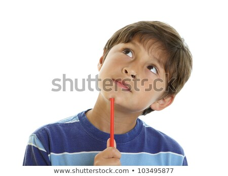 school boy thinking while holding pencil stock photo © stockyimages