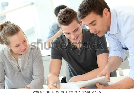 Three university students working on assignment Stock photo © photography33