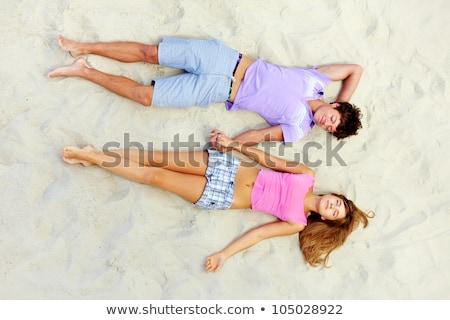 カップル · 青少年 · 寝 · ビーチ · 少女 · 砂 - ストックフォト © photography33